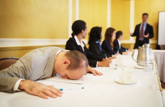 Businessman Sleeping During Conference Presentation